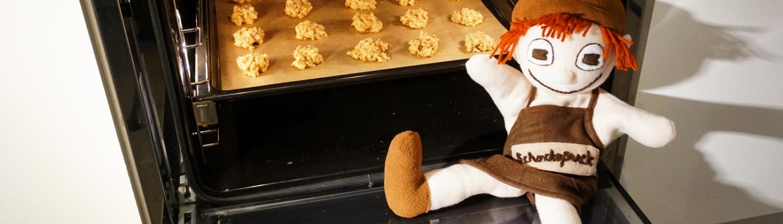 Der Schokopuck hat seine Haferkekse in den Ofen geschoben, nun backen sie 15 Minuten