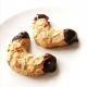 zwei selbstgebackene Mandelhörnchen mit Schokoladenglasur an den Enden, Hauptzutat Marzipan